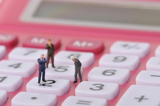 Payroll services. Impact People. Little businessmen on calculator.